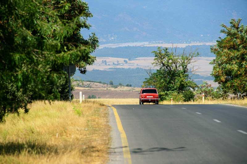 Ivanovka countryside road Lada car